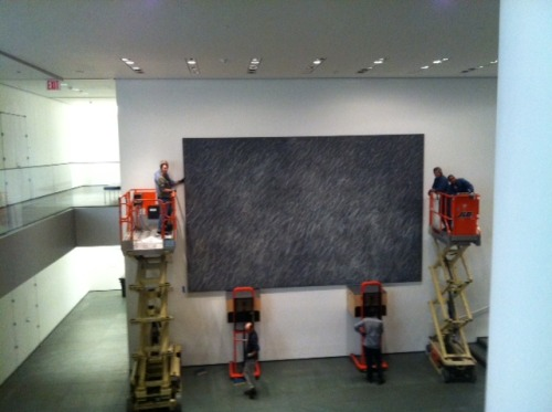 Have you ever wondered what it takes to get a 21-foot-wide painting up onto a museum wall? More than a hammer and nails, to be sure! We recently installed Cy Twombly's monumental Untitled (1970) in MoMA's main lobby—an undertaking that required a crew of nearly 20 skilled staff members, two forklifts, five hours, and a bevy of staples. (via MoMA)