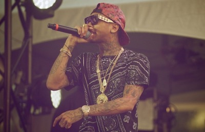 YMCMB's Tyga at the 2012 Ottawa Bluesfest this past weekend in Canada. He's wearing a Supreme red snakeskin hat [F/W 2011] and CÉLINE gold chain frames [USD $3,999].