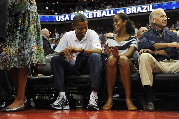 WASHINGTON, DC - JULY 16: President Barack Obama shares a his daughter Malia, as the US Senior Men's National Team and Brazil play during a pre-Olympic exhibition basketball game at the Verizon Center on July 16, 2012 in Washington, DC. (via Photo from Getty Images)
