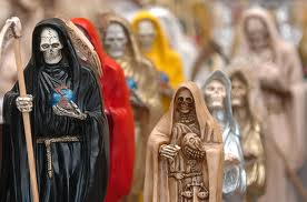"SANTA MUERTE Santa Muerte is a sacred figure venerated primarily in Mexico and the United States, probably a syncretism between Mesoamerican and Catholic beliefs.  The name literally translates to ""Holy Death"" or ""Saint Death.""  Mexican culture since the pre-Columbian era has maintained a certain reverence towards deathwhich can be seen in the widespread Mexican celebration of the syncretic Day of the Dead. Catholic elements of that celebration include the use of skeletons to remind people of their mortality.  Santa Muerte generally appears as a skeletal figure, clad in a long robe and carrying one or more objects, usually a scythe and a globe. The robe is most often white, but images of the figure vary widely from person to person and according to the rite being performed or the petition of the devotee. As the worship of Santa Muerte was clandestine until recently, most prayers and other rites are done privately in the home. However, for the past ten years or so, worship has become more public, especially in Mexico City. The worship is mainly condemned by the Catholic Church in Mexico, but not by the Church world-wide under the aegis of the Pope, (or the Vatican of which he heads) and it is firmly entrenched among Mexico's lower working classes and various levels of the criminal world. The number of believers in Santa Muerte has grown over the past ten to twenty years, to approximately two million followers at least and has crossed the border into Mexican American communities in the United States. Santa Muerte should not be confused to be identical with the Argentinian folk-saint San La Muerte, as the two are ascribed similar powers and are venerated with similar rituals. Santa Muerte is referred to by a number of other names such as Señora de las Sombras (""Lady of the Shadows""), Señora Blanca (""White Lady""), Señora Negra (""Black Lady""), Niña Santa (""Holy Girl""), and La Flaca (""The Skinny One""). Sometimes the name is listed as Santa Sebastienne or St. Sebastienne, (""Our Beautiful Lady Sebastienne""), as St. Sebastian was an early Christian martyr and is, among other things, patron saint of a holy death. Images of Santa Muerte are generally individualistic and personal. No two are exactly the same. Sizes vary immensely from small images held in one hand to those requiring a pickup truck to move. Some people even have the image tattooed on their bodies. The appearance of the ""Black Lady"", ""White Lady"", etc. vary, but all are dressed either in long robes or (less commonly) long dresses, covered from head to feet with only the face and hands showing. This symbolizes how people hide their true selves from the rest of the world. The robe or dress covers the skeletal figure like flesh covers the bones of the living. Both are said eventually to fall away. The most common image is Santa Muerte in a robe, with a scythe in the right hand and the globe in the left. The robed image of Santa Muerte looks a bit like that of the Virgin of Guadalupe, the patron saint of Mexico. However, there are many variations of the robe's color, and what Santa Muerte holds in her hands. Interpretations of the robe color and carried objects can vary as well. The two most common objects that Santa Muerte carries are a scythe and a globe. The scythe can symbolize the cutting of negative energies or influences. Also, as a harvesting tool, it can symbolize hope and prosperity. It can represent the moment of death, when a scythe is said to cut a silver thread. The scythe has a long handle, indicating that it can reach anywhere. The globe represents Death's dominion, and can be seen as a kind of a tomb to which we all return. Having the world in her hand also symbolizes vast power.  http://en.wikipedia.org/wiki/Santa_Muerte"