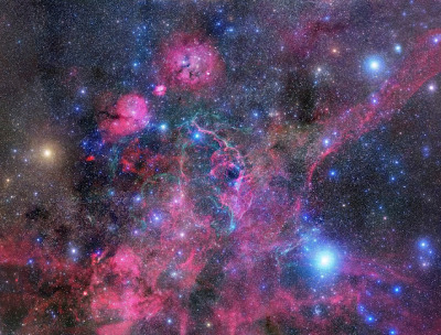 ancient-magics:  The plane of our Milky Way Galaxy runs through this complex and beautiful skyscape. At the northwestern edge of the constellation Vela (the Sails) the 16 degree wide, 30 frame mosaic is centered on the glowing filaments of the Vela Supernova Remnant, the expanding debris cloud from the death explosion of a massive star. Light from the supernova explosion that created the Vela remnant reached Earth about 11,000 years ago. In addition to the shocked filaments of glowing gas, the cosmic catastrophe also left behind an incredibly dense, rotating stellar core, the Vela Pulsar. Some 800 light-years distant, the Vela remnant is likely embedded in a larger and older supernova remnant, the Gum Nebula. The broad mosaic includes other identified emission and reflection nebulae, star clusters, and the remarkable Pencil Nebula.