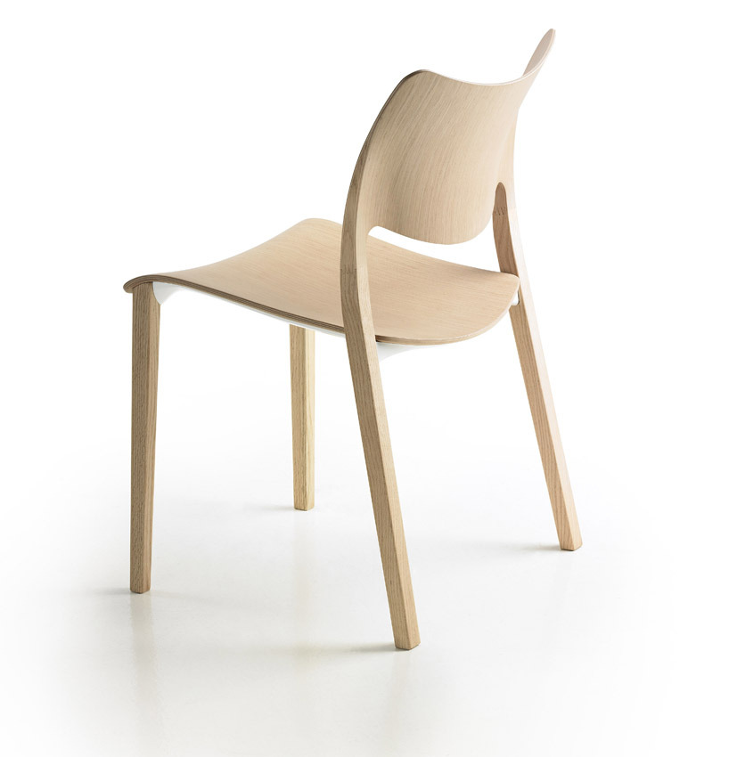 leibal:  Laclasica Chair is a minimalist chair designed by Spanish-based designer Jesús Gasca. The stackable wooden chair combines traditional principles of seating with modern ergonomics and aesthetics. The seat-back mimics the form and curves of the human body while conveying a fluid form toward the legs and seat pan.