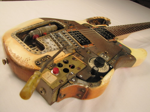 "Tony Cochran Guitars created the Kamikazecaster guitar, commissioned by Dracula's Cabaret in Gold Coast Australia for Dave Kume, aka Kamikaze D, lead guitarist. Dracula's Cabaret is Australia's longest running and most successful dinner theater … or circus! The new show, Transfusion, ""features fast paced vampire variety that combines acerbic comedy, wicked burlesque, bizarre human circus and off the dial madness."" Check out the video of the wild guitar solo on the Kamikazecaster by Kamikaze D … even in an aerial act! VIDEO at www.facebook.com/TonyCochranGuitars"