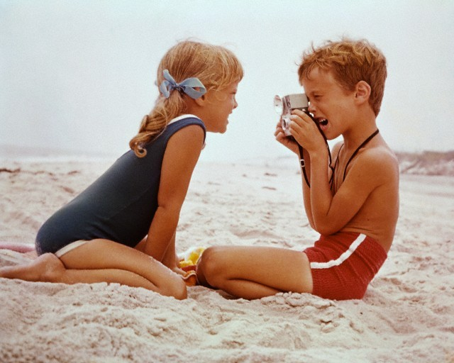 Young photographer and muse at a New York beach