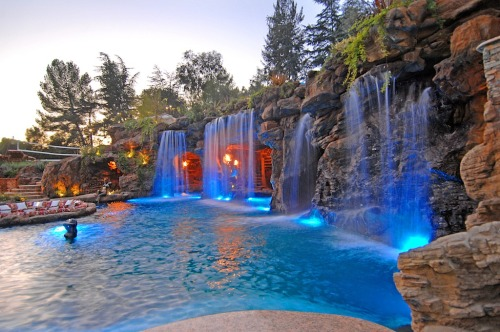 Grotto swimming pool with lights on. Follow us on Facebook!  CLICK HEREVisit Pricey Pads