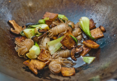 Yam noodles, tofu, chinese mushrooms and baby bok choy in spicy brown sauce. I love Hong Kong Market!