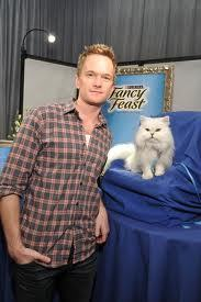 Your argument is invalid. Here's a picture of NPH next to the Fancy Feast cat.