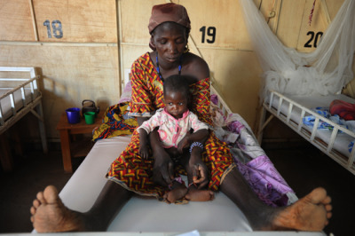 Malnutrition in the Sahel: One Million Children Treated, But What's Next?In this interview, MSF pediatrician Susan Shepherd and MSF nutrition specialist Stéphane Doyon Discuss the situation in the Sahel RegionOne million children suffering from severe malnutrition will be treated this year by governments and aid organizations across the Sahel. How should we interpret this number?Susan Shepherd: It's both a failure and a success. The failure is that each year, countries within the Sahel will face recurrent, large-scale nutritional crises that are growing even worse in some countries. One million malnourished children—that's an enormous figure. But the most important take away from this year is how all of the aid actors—governments, United Nations agencies, and NGOs—have managed the crisis. Because of this, the major success is that for the first time, one million malnourished children will be treated in the Sahel, and the vast majority of these one million children will recover.Stéphane Doyon: Prior to the 2005 nutrition crisis in Niger, malnourished children didn't receive treatment and childhood malnutrition was virtually unrecognized. One million malnourished children receiving treatment doesn't necessarily imply things are getting worse, but rather implies a major step forward in treatment. Improved malnutrition management results in large part from the political will summoned by the governments who wish to tackle this pathology. For the first time since the 2005 nutritional crisis in Niger, the most-affected countries have implemented ambitious response plans for treating malnourished children and establishing early preventive measures. Donors have committed to funding programs for therapeutic foods and nutritional supplements that are adapted to the needs of infants, even if all the funds have not yet been released.Read the rest of this interview here.   Photo:A mother and her two-year-old await treatment at an MSF Inpatient Therapeutic Feeding Center in Niger.  Niger March 2012 © Julie Remy