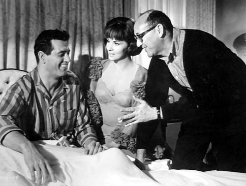 Rock Hudson laughs heartily at something Strange Bedfellows director Melvin Frank is saying. Gina Lollobrigida looks on