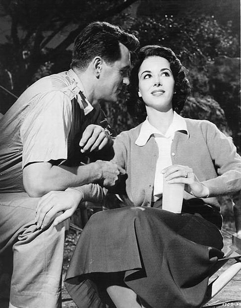 Rock Hudson and Dana Wynter take a break on the set of Something of Value