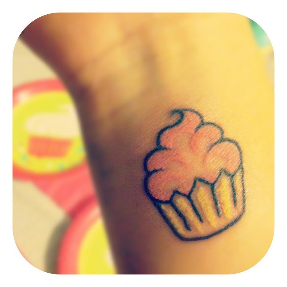 fuckyeahtattoos:  This is my third tattoo, a pink cupcake. It was done by Ryan from Asylum Tattoo located on Bedford Ave in Brooklyn. It represents my love for cupcakes, the color pink and baking. A hobby of mine which I find to be therapeutic and fun. (@thugjuice)