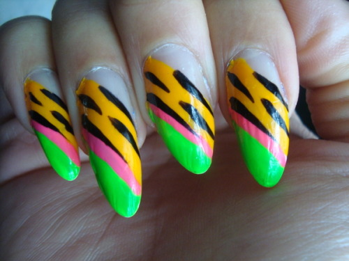 beautylish:  Meow! Lovin' this neon jungle cat mani by Dangerously E.!