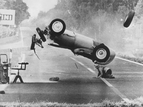 Hans Herrmann, bailing during the 1959 German GP. He survived, largely unscathed.