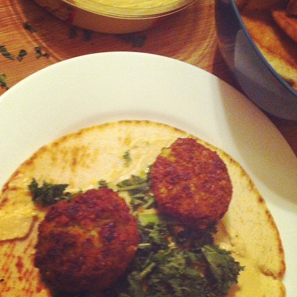 Falafel with kale, hummus, and homemade baked pita chips. #dinnersoftheobese  (Taken with Instagram)