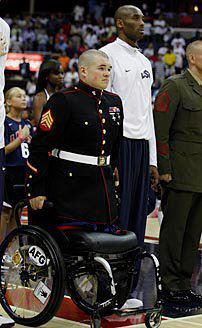 h0t-southern-mess:  kelleywong:  Sgt. Zachary Stinson, USMC, uses his arms to stand for the playing of the National Anthem. Words cannot explain how inspiring this is.   I know I just reblogged this, but I don't care. This man has so much of my respect. God bless him.
