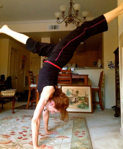 Inverted Leg/Thigh Stretches Since I can't really figure out how to balance without the wall, I put the wall to good use: In a hand stand, I like to leave one foot flat against the wall while I move the other leg as forward (and down) as I can get it.  Try and hold and breath and hold, then switch legs.   Feels great to stretch.