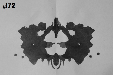 inkblotoftheday:  Inkblot #172 Instructions: Tell me what you see. -Enjoy  two cloaked women exchanging something (knives, grabbed by the blade in politeness?) across a strange table