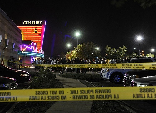 "breakingnews:  Gunman opens fire at Colorado movie theater, killing at least 12 Update (8:31 a.m. EDT): Colorado police spokesman revises death toll and says at least 12 dead in movie theater attack, AP reports. NBC News: Fourteen people were killed and at least 50 others wounded early Friday when a gunman opened fire at a midnight screening of the summer blockbuster ""The Dark Knight Rises"" near Denver, authorities and witnesses said. Aurora Police Chief Dan Oates told reporters that 10 people died at the scene and four others died after being taken to local hospitals. A three-month-old and a six-year-old girl were among those treated, according to reports. More updates on BreakingNews.com. Photo: Police responded to a shooting at the Century 16 movie theater in Aurora, Colorado, early this morning. (Karl Gehring / The Denver Post via nbcnews.com)"
