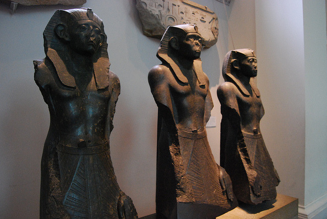 Three statues of King Senusret III  by konde on Flickr. Three statues of King Senusret III Three black granite statues of King Senusret III.These three statues exhibit the fine portrait quality of Egyptian sculptures during the late 12th dynasty. The faces are excellently worked, although the ears are over-large in common with many statues of the period.12th Dynasty, Deir el Bahri.