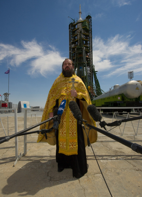 A Russian Orthodox priest blessing a Soyuz spacecraft, as it sat on the launchpad on the Kazakh steppe. (HT The Atlantic)