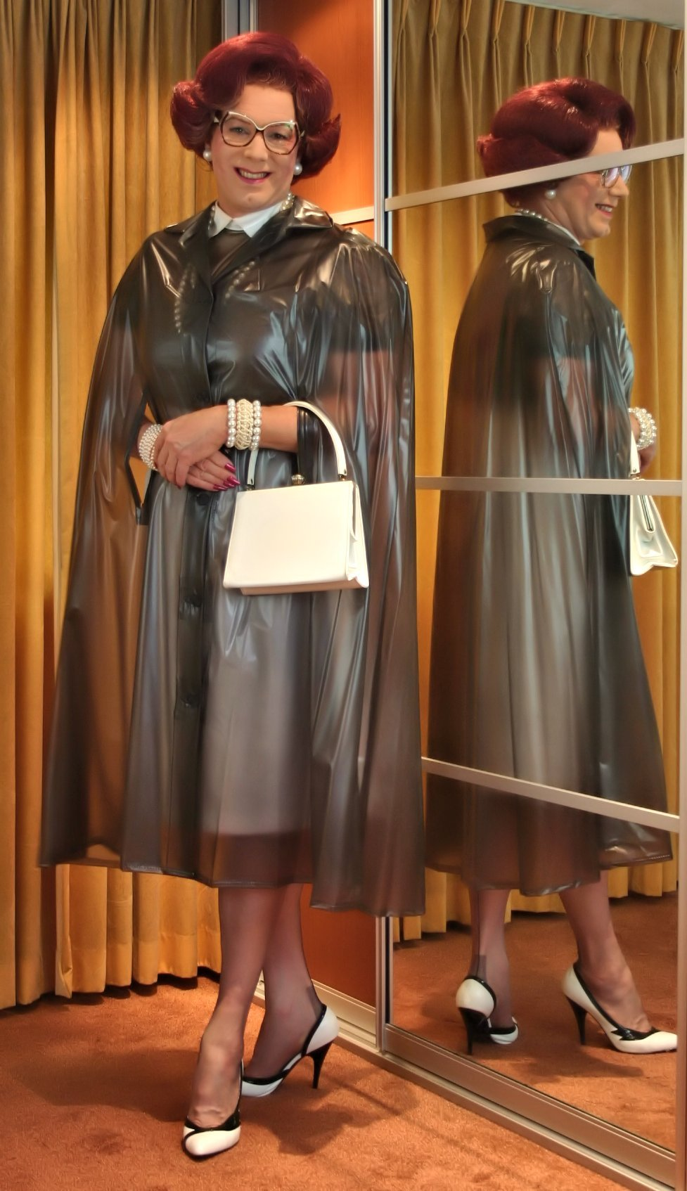 Very soft and smooth smokey grey transparant PVC rain cape, with a