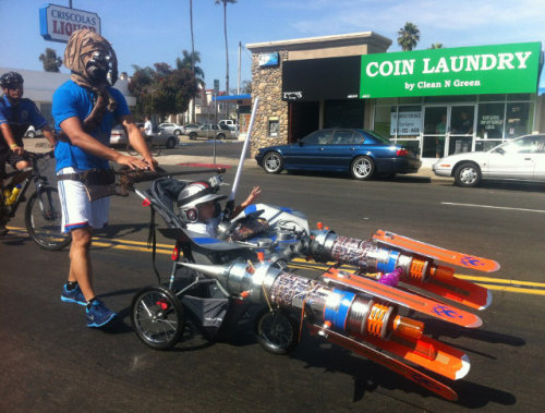 iheartchaos:  Tusken raider spotted pushing a baby pod racer Where? Only at San Diego Comic Con. Or Portland on any given day. Via