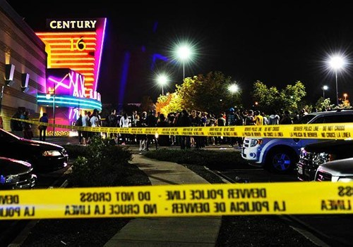 "Breaking News: Gunman Kills 12 At Colorado Dark Knight Rises Premiere: A lone masked gunman armed with a rifle, a shotgun, and two handguns entered a movie theater outside Denver, CO, this morning just minutes after the 12:05 a.m. premiere of The Dark Knight Rises began, killing at least 12 people and wounding 38. A witness said the gunman entered the Aurora theater through the emergency exit door, ""threw a canister across the theater,"" unleashing gas, ""then started shooting."" Another witness said movie-goers were confused when the shooting started because they thought the sound of gunfire was coming from the movie. A third witness said, ""He looked so calm when he did it."" The suspect, whom federal authorities have identified as 24-year-old James Holmes,was arrested outside the theater. A search of his apartment uncovered more explosives. Holmes had no history with police other than a traffic ticket. In reaction to the tragedy, Warner Bros. has canceled the Paris premiere of The Dark Knight Rises, issuing a statement saying the company ""is deeply saddened to learn about this shocking incident."" [lat]"
