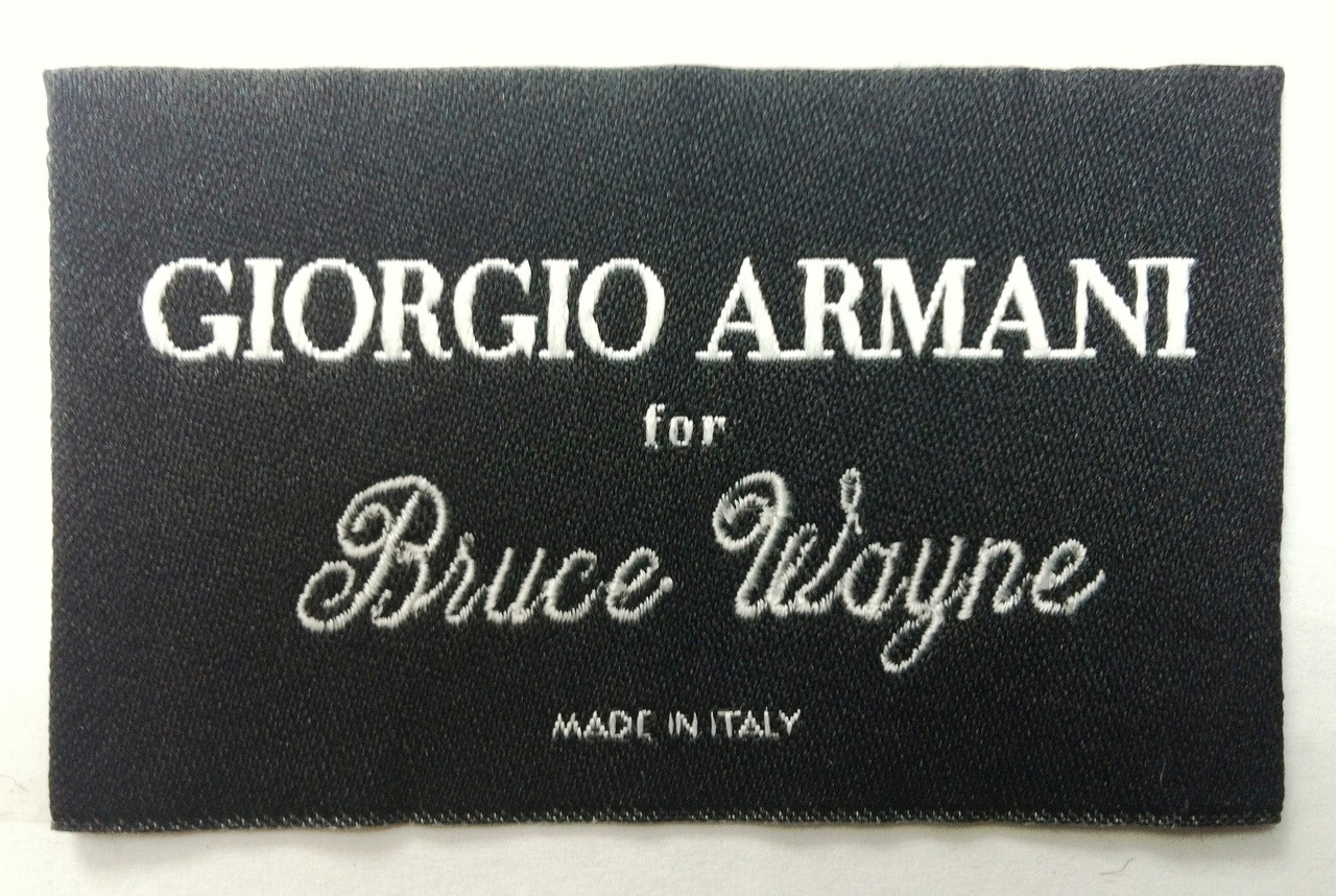 'nuf said. wgsn:  Does it get much cooler than Giorgio Armani for Bruce Wayne?! The Italian designer has worked with Oscar-winning costume designer Lindy Hemming to create made-to-measure suits for Christian Bale as Batman's alter ego, in the latest of Warner Bros' Dark Knight trilogy, The Dark Knight Rises.
