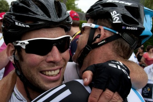 Stage winner, Great Britain's Mark Cavendish (L) celebrates with teammate, Australia's Michael Rogers after crossing the finish line at the end of the 222,5 km and eighteenth stage of the 2012 Tour de France cycling race starting in Blagnac and finishing in Brive-la-Gaillarde, southwestern France, on July 20, 2012. (via Photo from Getty Images)