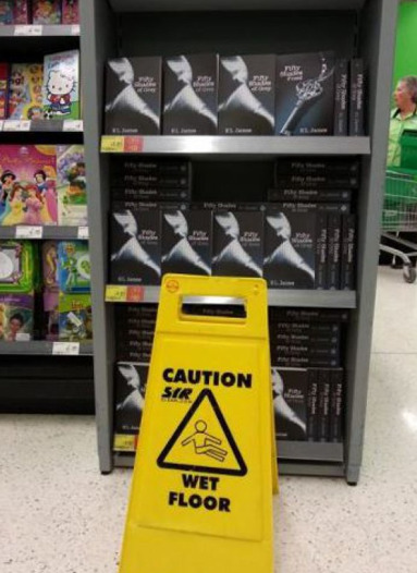 "Wet Floor Sign in Front of ""50 Shades of Grey"" The most dangerous part of the book store."