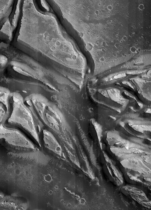 "islands of the dead: The surface of Mars, photographed by Mars Reconnaissance Orbiter, 3rd May 2007. ""Possible late stage faulting in the Granicus and Tinjar Valles"". This area is centred around 35°N 125°E, just northwest of Elysium Mons. Detail taken from a composite of 28 photographs by the HiRISE instrument.  Image credit: NASA/JPL/UoA. Composite: AgeOfDestruction."