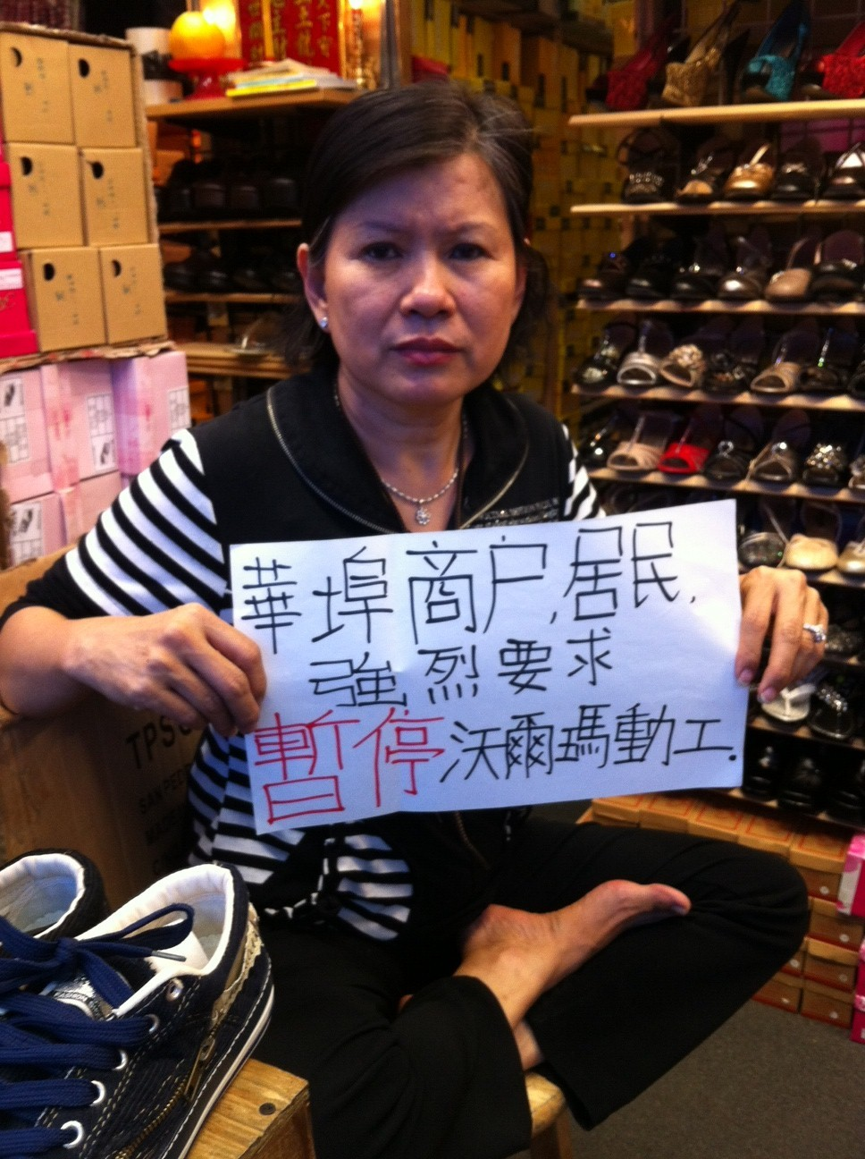 Chinatown small business owner opposes Wal-Mart. We all see the ramifications of Wal-Mart moving in.