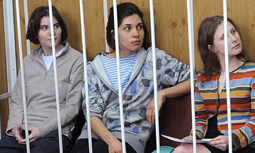 "RUSSIA EXTENDS JAILING OF PUSSY RIOT BY 6 MONTHS By Gabriela Baczynska MOSCOW, July 20 (Reuters) - Three members of female punk group Pussy Riot who derided President Vladimir Putin in a protest in Moscow's main cathedral had their spell in jail extended by six months on Friday in what their lawyers called a show trial dictated by the Kremlin. The women, who have been held in pre-trial custody for almost five months, face up to seven years in jail on charges of hooliganism for storming the altar in multi-coloured masks to sing a ""punk prayer"" to the Virgin Mary to ""Throw Putin Out!"" Pussy Riot's brazen act was part of a protest movement against Putin's 12-year dominance of Russia that at its peak saw 100,000 people take part in winter demonstrations in Moscow. The Feb. 21 protest, which offended many believers in the mainly Orthodox Christian country, exposed deep divisions over the church leadership's backing for Putin and the scale of punishment faced by the women, two of whom have young children. Defence lawyer Mark Feigin said the court's acquiescence to a prosecution request to hold Maria Alyokhina, Nadezhda Tolokonnikova and Yekaterina Samutsevich until Jan. 13, 2013, showed Russian leaders had given orders for their conviction. ""Today's decision only proves again that our role as defendants here is a pure formality,"" Feigin told reporters after the hearing, which was closed to the media. ""There is a lot of evidence that the judge will disregard justice in favour of a pre-set instructions on how to rule, which have been handed down by the authorities. They want to find them guilty… to punish them with real jail time. ""It is not a process but a judicial reprisal,"" he said. Putin and the head of Russia's Orthodox Church, Patriarch Kirill, are among more than 30 people Feigin and his two colleagues want to call to testify as witnesses in the trial. After the Pussy Riot performance, Kirill said the Church was ""under attack by persecutors"". The patriarch has often praised Putin and in February likened his 12-year rule to a ""miracle of God"". Though neither the president nor the patriarch is likely to testify, defence lawyers said the request pointed to those they believe were pulling strings behind the scenes. ""They are trying to make it look like an attack on Russia by some dark powers. It is just a theatre of the absurd, not a real court,"" said Nikolai Polozov, another defence lawyer.  RECALLING KHODORKOVSKY Court spokeswoman Darya Lyakh said a date would be announced on Monday for the start of the high-profile trial, which has drawn comparisons to the jailing of former oil tycoon, billionaire and Putin critic Mikhail Khodorkovsky. The Pussy Riot hearing on Friday took place in the same Moscow where Khodorkovsky's second trial took place. Outside, Orthodox Church faithful mingled warily with Pussy Riot backers, some of whom wore T-shirts emblazoned with the band's trademark brightly coloured balaclavas. A church activist read Bible passages out loud, while one of the women's supporters unfurled a banners ""Throw Putin Out!"", raising chants of ""Freedom, Freedom!"" before he was detained. ""Believers' feelings are not worth a prison sentence,"" read another sign held aloft, before rain dispersed the crowd. The three women's arrest has drawn widespread outrage among human rights groups and opposition activists already fuming over the church's backing of Putin in a presidential election he won in March. Amnesty International has urged Russia to free the trio, criticising the severity of the response by authorities. ""The authorities have again chosen to take the toughest measures against Pussy Riot,"" said Tolokonnikova's husband, Pyotr Verzilov. He added that this would ""only provoke more outcry in society and provoke more support for the girls."" But some Orthodox believers have called for tough punishment for an act they regard as blasphemous. ""I was really upset at what happened,"" said Vadim Kvyatkovsky, a member of an Orthodox Christian youth group. ""This was no act of art. If it was happening anywhere else, in the street, we could discuss that, but when it is in a cathedral then it just violates our freedoms."" Half of Muscovites surveyed this month by the Levada Center, an independent pollster, said they had negative views about the prosecution of Pussy Riot members while 36 percent said they welcomed the criminal case.   SUPPORT PUSSY RIOT! PUNK SOLIDARITY!"
