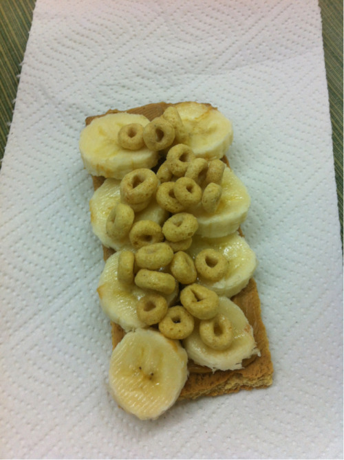 Graham cracker, peanut butter, and banana with honey nut o's By Chaitali