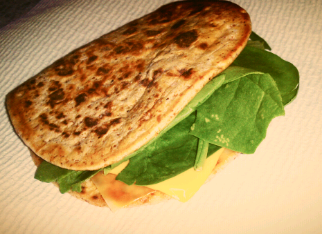 This grilled cheese sandwich with spinach. :D  Flatout Fold it Flat Bread One slice of real American Cheese One or two slice of Sargento Ultra thin Slice in Colby Jack A few leafs of spinach  In a pan put some Olive Oil Spray, then heat up one side of the flat bread. Turn the flat bread, add the cheese and spinach. Cover with a lid and wait a minute for everything to cook. Remove from the pan and start eating :D