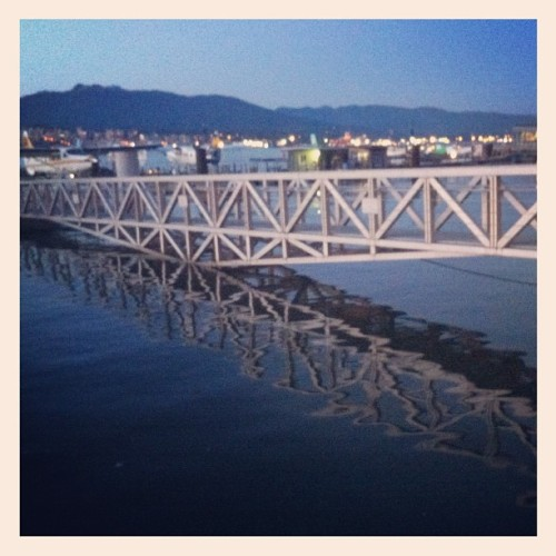 Bridge reflection in the ocean's water close to Vancouver Harbour Water Airport #intecer #bridge #reflections #water #ocean #vancouver #britishcolumbia #nature #sunset #instanature #walk #beautiful #evening #blue #light #night (Taken with Instagram)