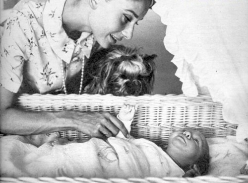 Audrey Hepburn with her new born Sean and Mr. Famous, 1960.