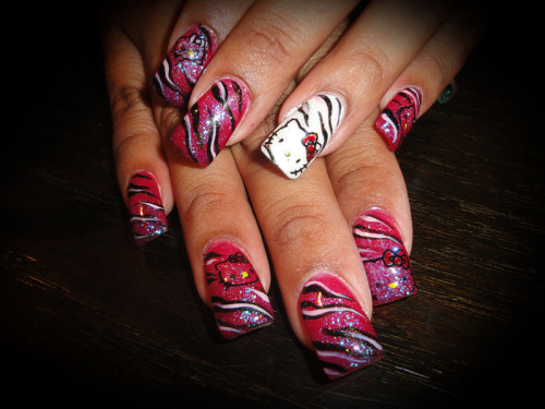 Hello Zebra Kitty…..nails by Dina  via PhotoToaster, using these settings.