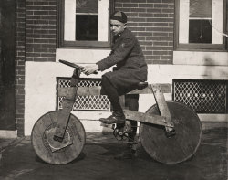 "Bernard J. ""Boompy"" Logue on his home made bicycle 2527 E. Monument Street, Baltimore, Maryland, USA, c.1920."
