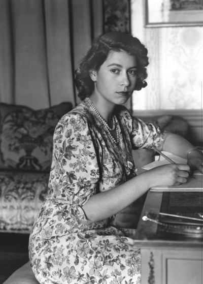 elizabethii:  Princess Elizabeth writing at her desk in Windsor Castle, Berkshire. 30th May 1944