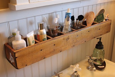 Wooden CD storage tower for great over-the-sink cubby holes.