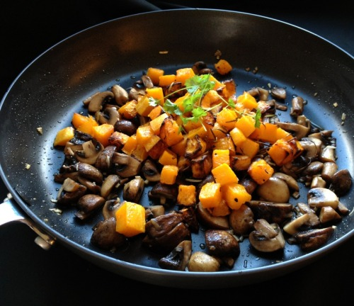 missminifer:  Roasted squash with garlic mushrooms and sage butter I wanted to make a topping or sauce for gnocchi that wasn't tomato based, and found variations of this recipe online. I think Nigel Slater has a similar recipe for lasagna with layers of squash and mushrooms. It looked rather autumnal in the pan, and went beautifully with the hot gnocchi and sage butter (photograph to follow).