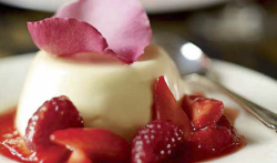 Rose water Panna Cotta with Red Berry Compote Serves 4 For the panna cotta 3 gelatin sheets400ml double cream100ml semi-skimmed milk75g caster sugar100ml half-fat crème fraîcheA few drops of rosewater (optional)A few drops of vegetable oil For the compote 300g strawberries, quartered150g raspberries2.5 tbsp caster sugar2 tbsp dessert wine1 tsp rosewater½ tsp lemon juiceOrganic rose petals to decorate 1 For the panna cotta, soak the gelatin sheets in a small bowl of water. Leave for 5 minutes, then gently squeeze out the excess water. 2 Place the gelatin, double cream, milk and sugar into a saucepan. Heat gently until the sugar dissolves, then addthe crème fraîche and mix thoroughly using a whisk. Stir in the rosewater and set aside. 3 Place a few drops of vegetable oil around the sides and base of each mould. Pour in the cream mixture and refrigerate for at least 4 hours, or overnight. 4 For the compote, put the strawberries, raspberries, sugar and wine in a pan and heat gently until the sugar has dissolved. Remove from the heat, then add the rosewater and lemon juice. Allow to cool, then refrigerate. 5 Remove the panna cotta from the moulds by dipping them in hot water for 2–3 seconds, then turning them out onto plates. Serve with warm or cold compote and decorate with organic rose petals.