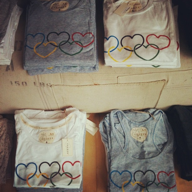 "We Heart The Olympics! Show your pride with our Canadian-made Shared Olympic tees! Perfect for cheering on our nation while they compete for gold in London. Talk about wearing your heart on your ""sleeve."" Take one home today. (Photo by Margie N.)"