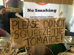 A #sign from the farmers market. This farmer actually had a whole table full of tomatoes. I was unsure which one to not squeeze.