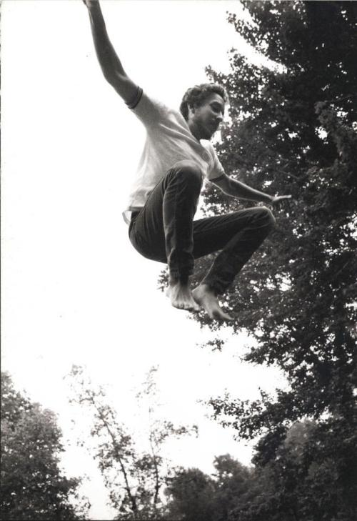 Bob Dylan jumping at his home on Ohayo Mountain Road, Woodstock.Photo by Elliot Landy