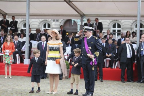 Princess Claire of Belgium, Prince Laurent of Belgium and their twin sons Prince Nicolas and Prince Aymeric look on during a military parade to celebrate Belgium's National Day on July 21, 2012 in Brussels.