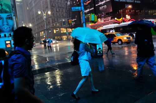 People walk through heavy rain at Times Square in New York, July 18, 2012 Shannon Stapleton