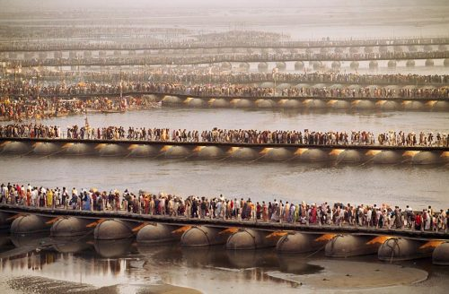 """Crowds at the Kumbh Mela await their turn to bathe in the Ganges. Allahabad, India. Photo © Steve McCurry/Magnum Photos""  McCurry, in my opinion, is the world's greatest living photographer. More from his Simple Act of Waiting series."