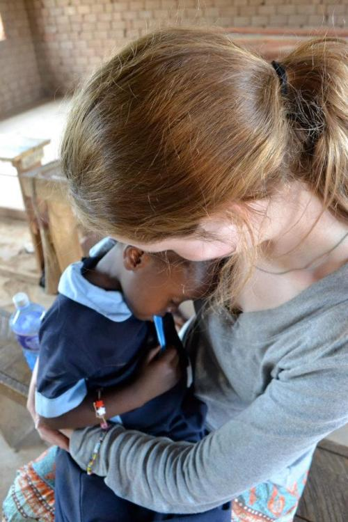 Sitting with an orphaned little girl that I met in a small village outside of Kisumu, Kenya. She had fallen down and hurt herself while playing with some of the other kids outside and then ran to me and fell asleep in my arms as I held her. Here name is Faith. Children like this are why my heart will always belong to Kenya <3